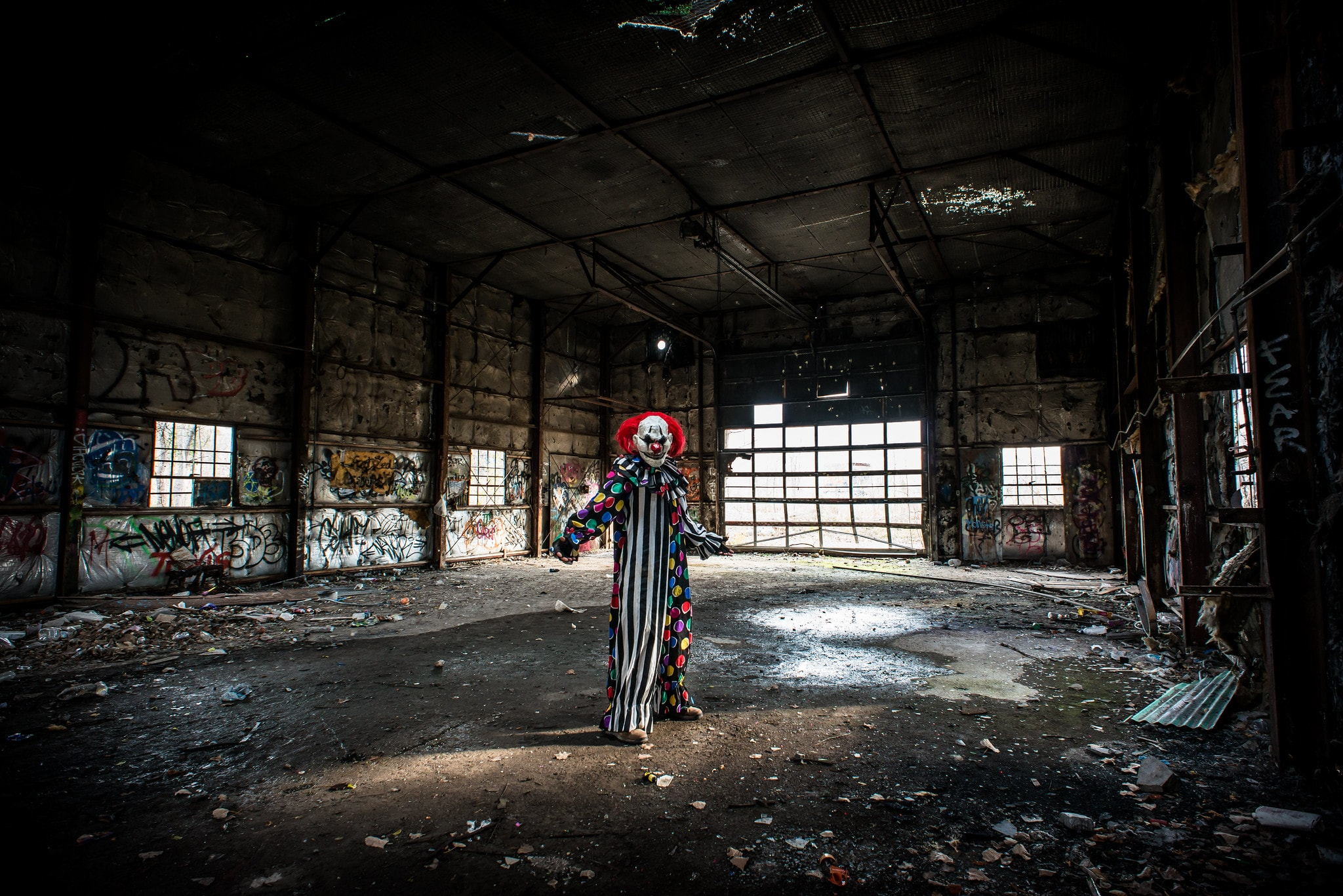 A scary clown in an abandoned building