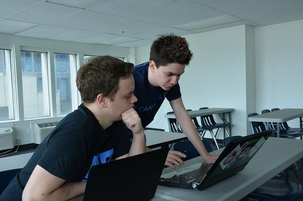 Sebastien (to the left), helping a developer at a hackathon