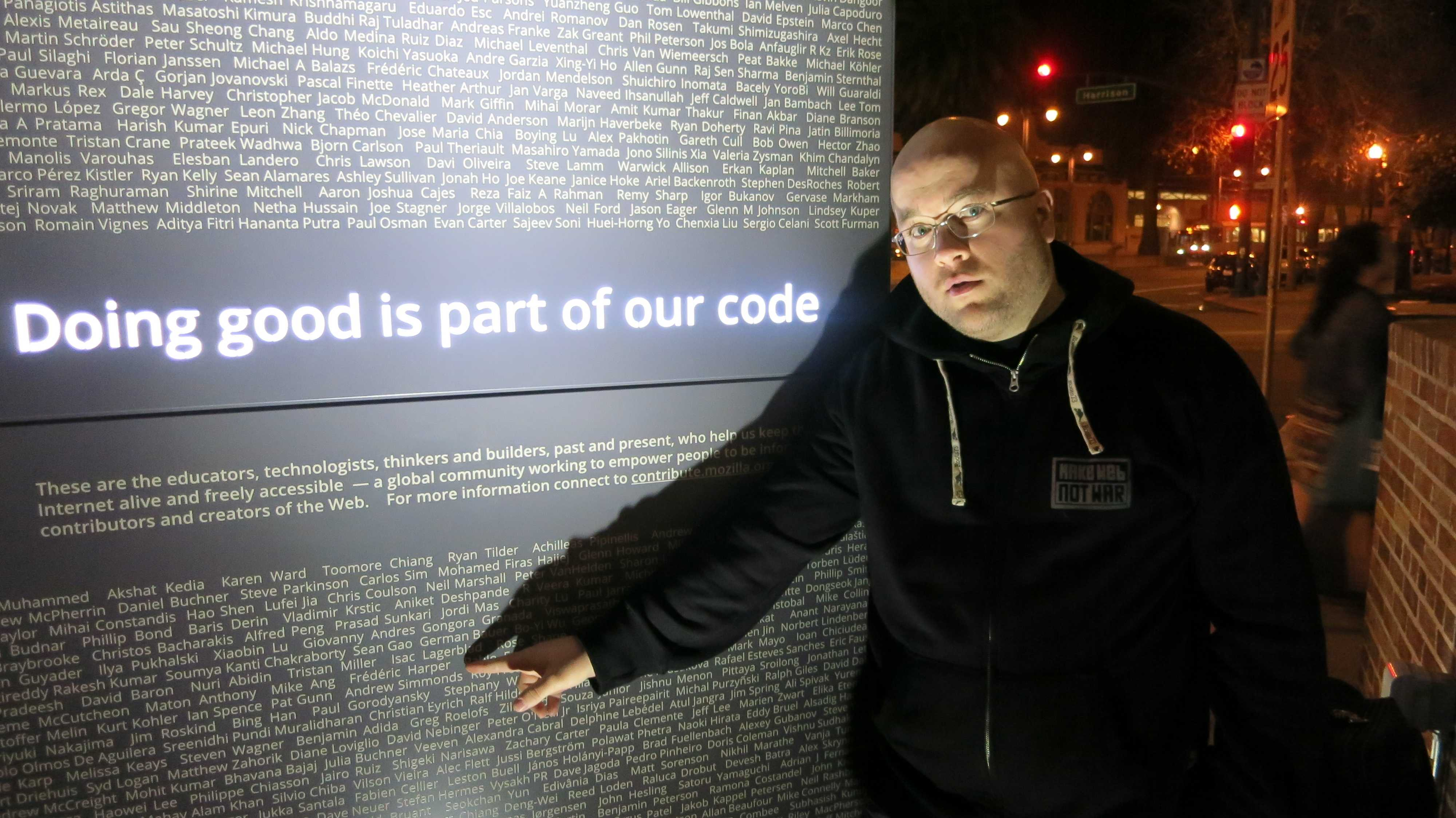Myself pointing my name on the Mozilla recognition statue