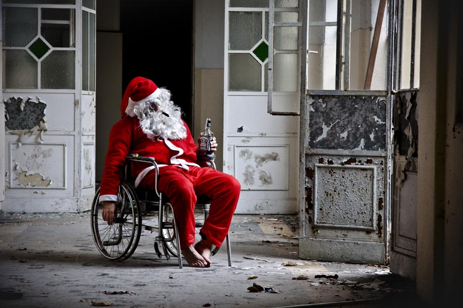 A drunk Santa in a wheelchair in a abandoned building