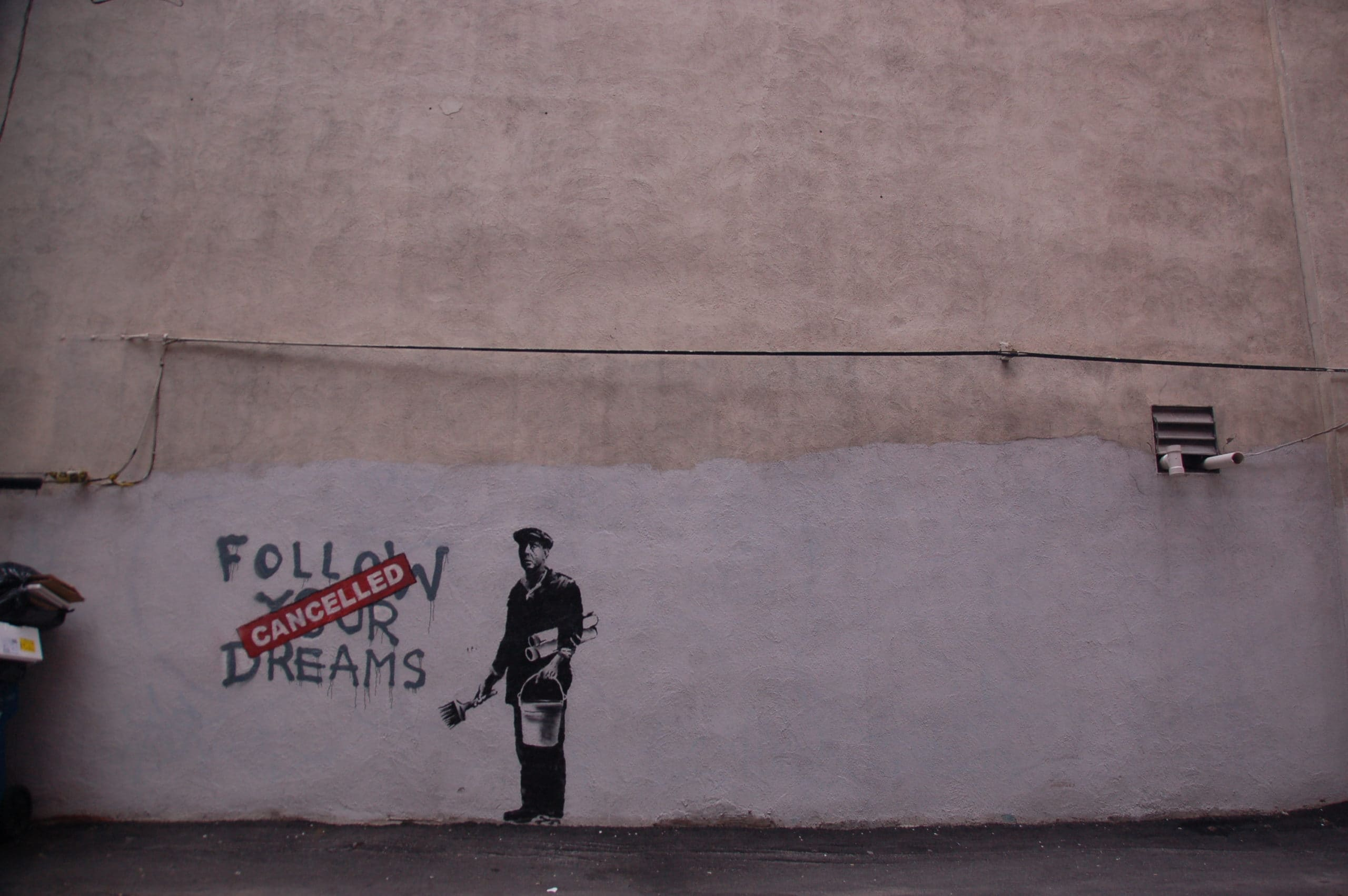 A grafiti Banksy style cancelling a follow your dream one