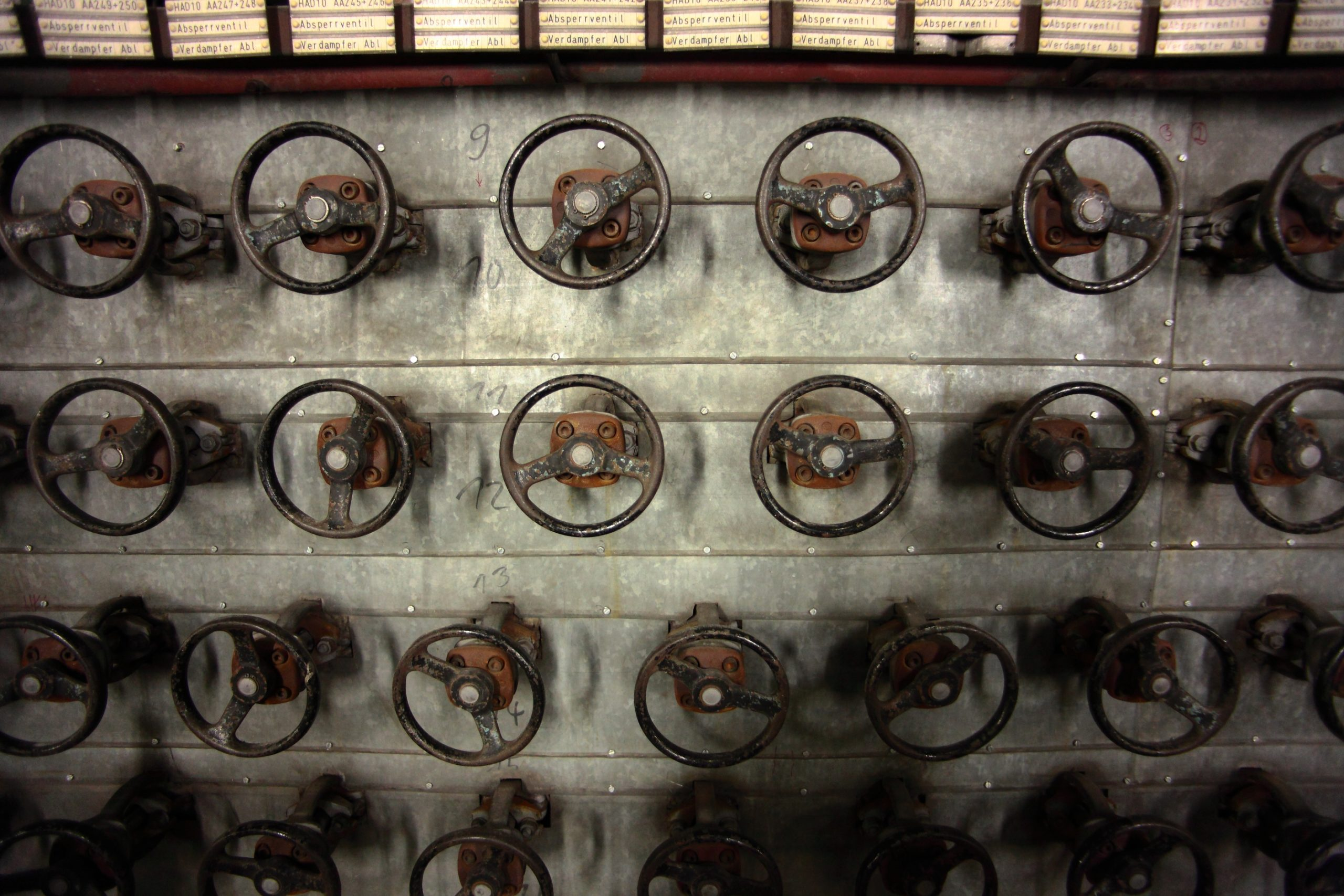 A wall full of steering wheels