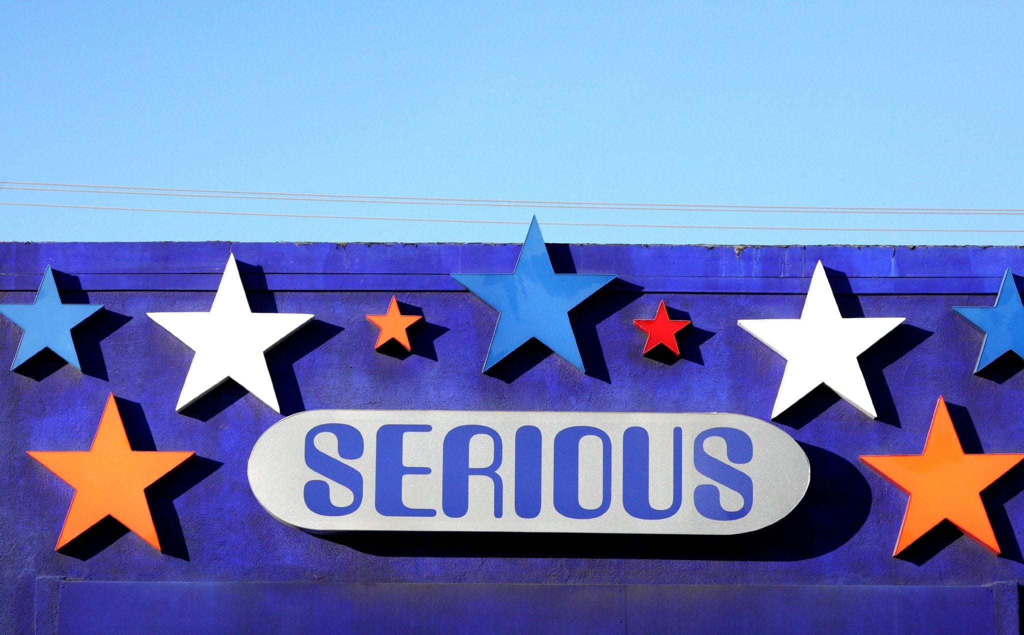 A building sign with stars and the word serious